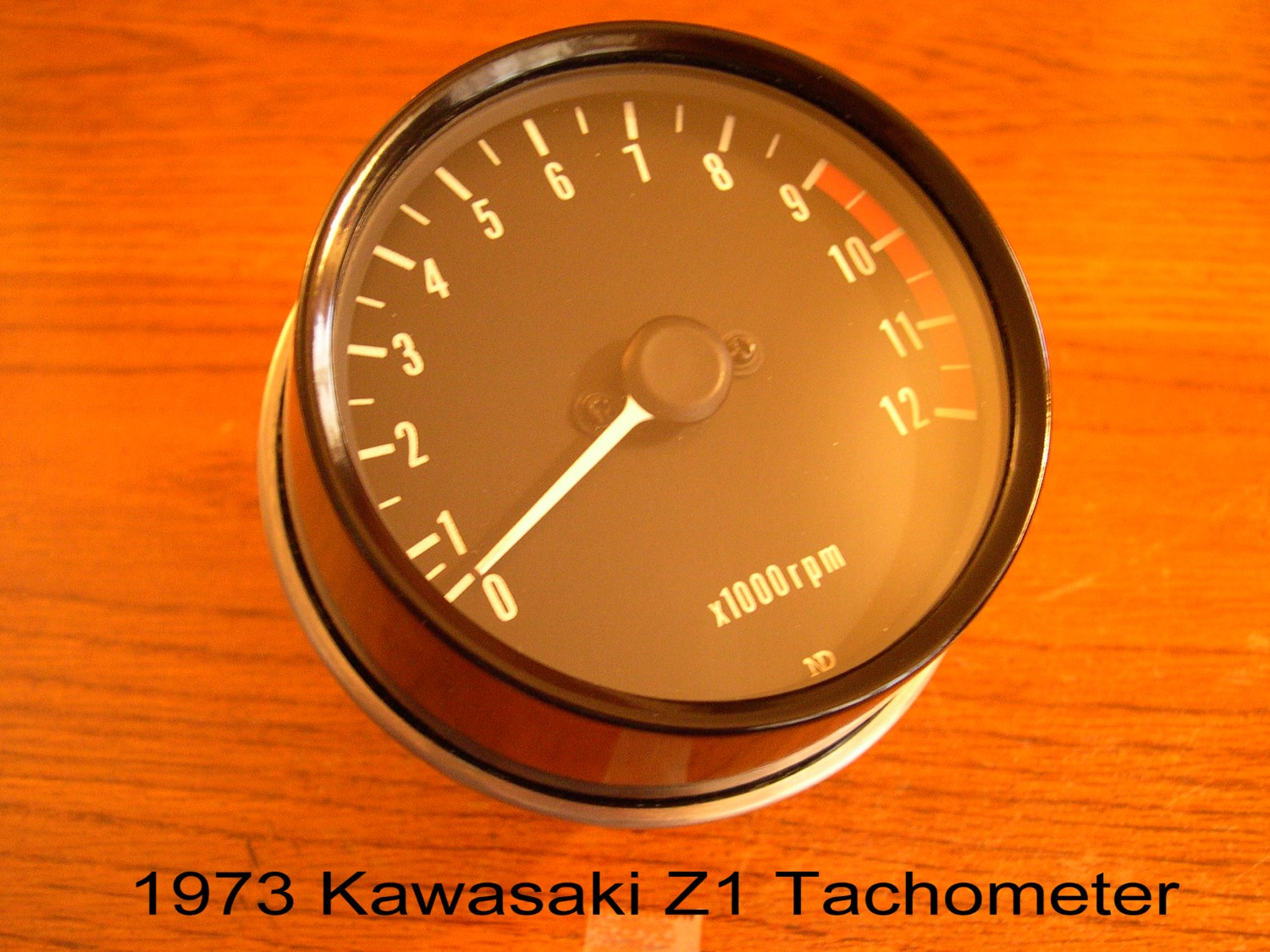 Like the 1973 Z1 speedometer, the tachometer has the same small ND very low  on the face. The redline starts at 9,000rpm and finishes at 12,000rpm